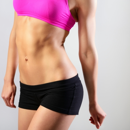 perfect fit: slim waist of young sporty woman, detail of perfect fit female body Stock Photo