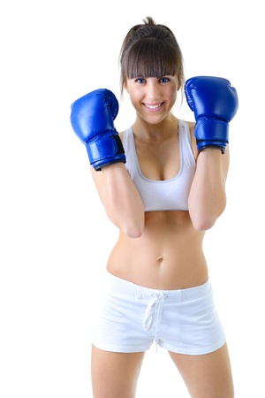 female boxing: sport young woman in boxing gloves, happy fitness girl studio shot over white background