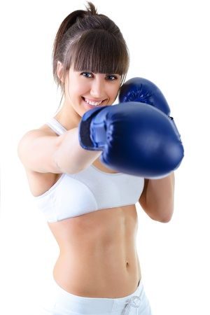 girl fighting: sport young woman boxing gloves, face of fitness girl studio shot over white background