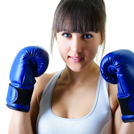 women fighting: sport young woman boxing gloves, face of fitness girl studio shot over white background