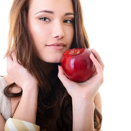 woman apple: Attractive teen girl with an apple against white background  Stock Photo