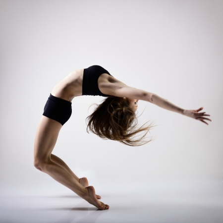 young beautiful dancer teen girl dancing and jumping, studio series Stock Photo - 20081347