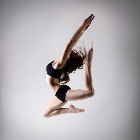 young beautiful dancer teen girl dancing and jumping, studio series photo