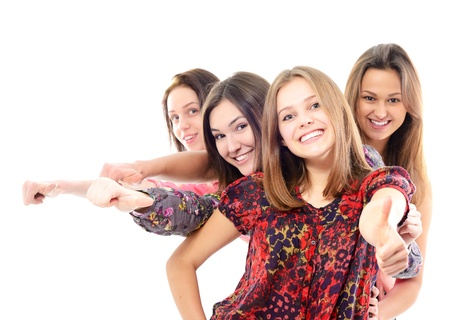 thumbs up of happy teen girls, over white background photo