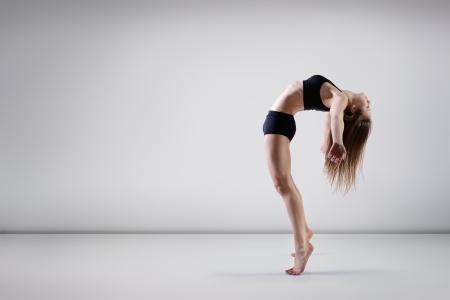 classical: young beautiful dancer teen girl dancing and jumping, studio series
