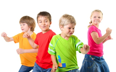 dancing pose: happy children dancing on a white background, healthy life, kids togetherness and happiness conccept