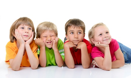 choleric: cute funny children in colored t-shirts lying and with interest looking right, over white background Stock Photo