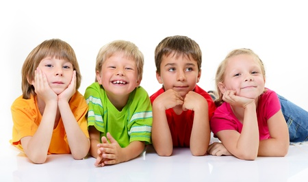 choleric: cute children in colored t-shirts lying and smiling, over white background