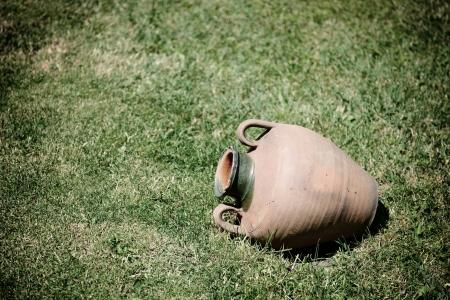 grassplot: ancient jug are on grass-plot, toned