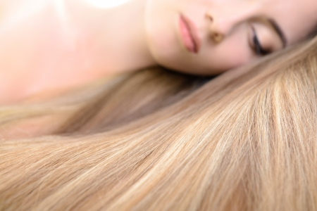 glassy: Hair. Beautiful bond girl with healthy long hair. Haicare and hairstyle. Stock Photo
