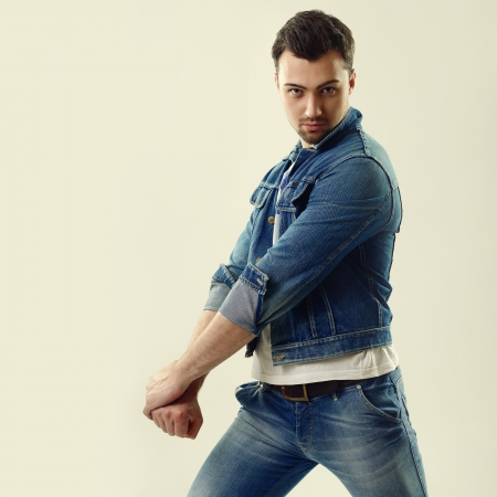 ooking: Portrait of handsome fashion young man in jeans