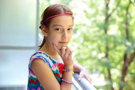 Portrait of  little girl on balcony, summertime