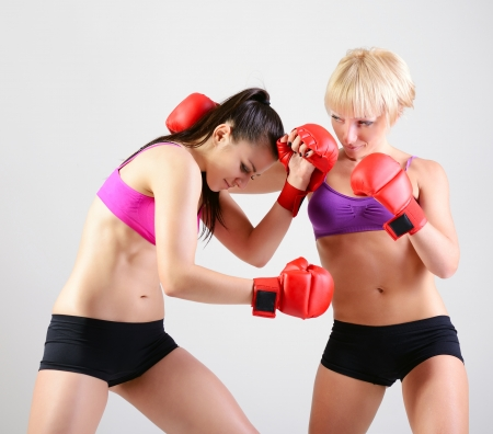 sport training of two boxing young woman photo