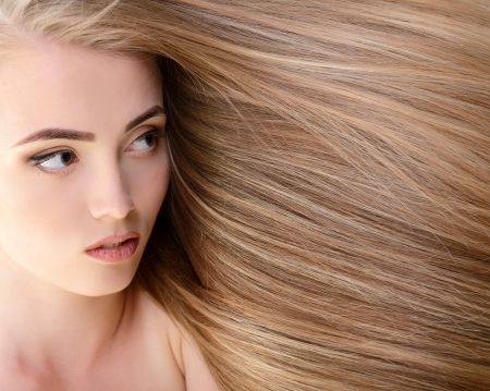 extension: Hair. Beautiful bond girl with healthy long hair. Haicare and hairstyle. Stock Photo