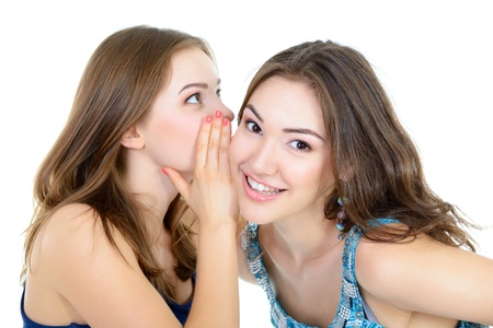 bruit: womans secret, two young beautiful women friends whisper funny news Stock Photo