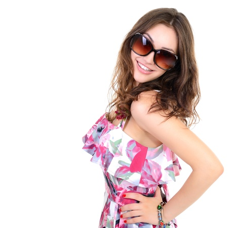 Beautiful cheerful confident young woman in sunglasses, over a white background  photo