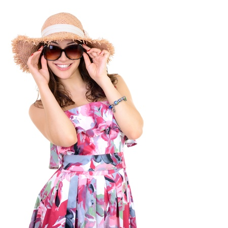 Beautiful cheerful confident young woman in sunglasses and straw hat, over a white background  Stok Fotoğraf
