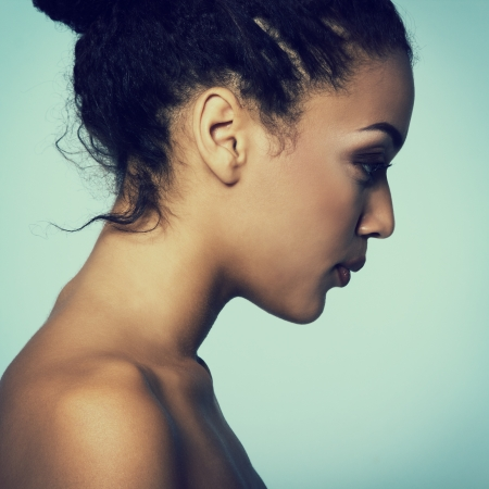 Beauty portrait of young mulatto fresh fashion woman in profile, toned photo
