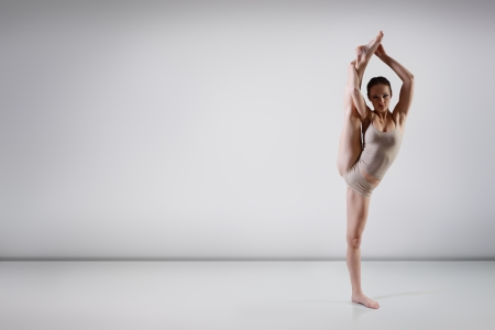 young beautiful dancer girl dancing, studio series photo