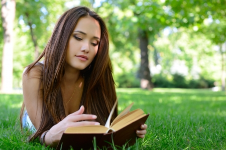 attractive gorgeous: beautiful girl reading book in the summer park