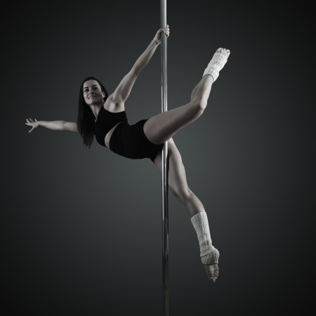 pole dancer, young woman dancing on pylon photo