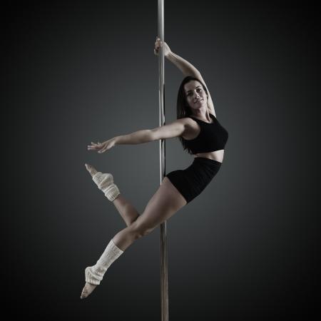 pole dancer dancing on pylon photo