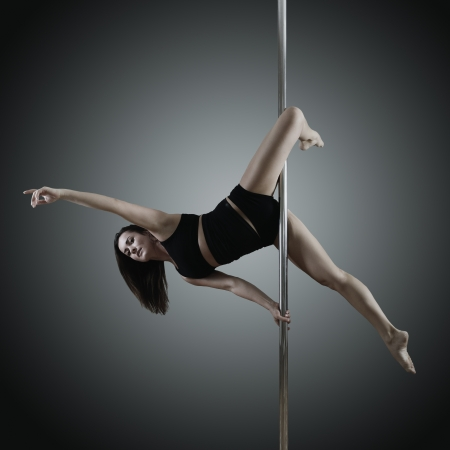 pole dancer dancing on pylon photo