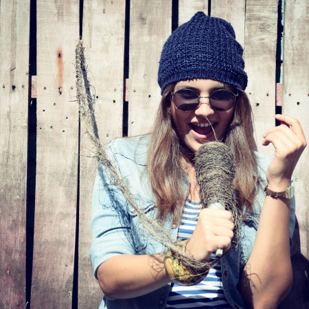 beautiful girl with glasses singing outdoor, young singer, toned image photo
