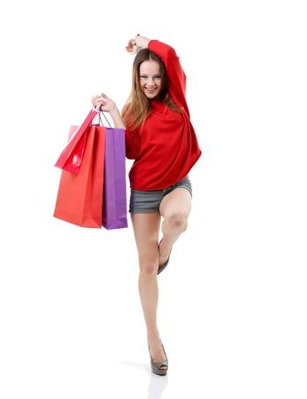hermosa ni�a feliz shopaholic adolescente con bolsas de la compra de colores, retrato de longitud completa sobre blanco photo
