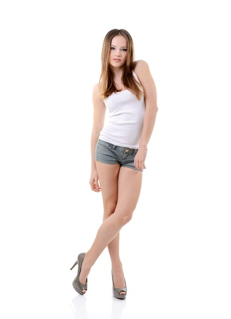 attractive happy teen girl full length portrait isolated on white background  photo