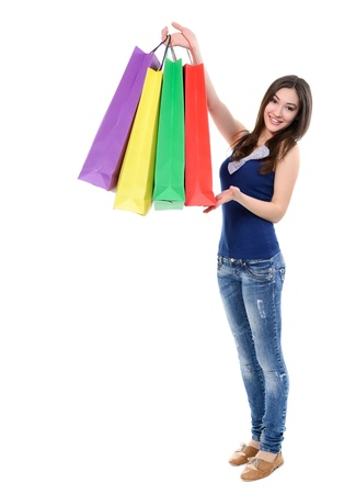 beautiful happy girl shopaholic with colored shopping bags, over white photo