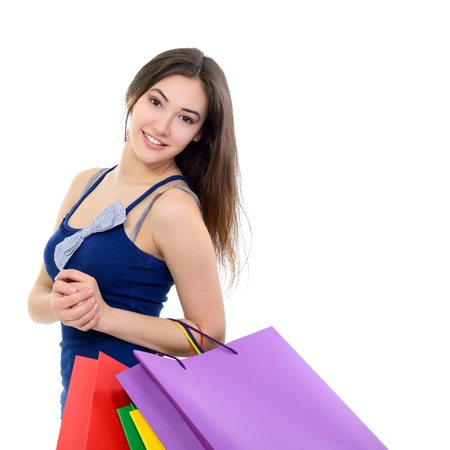 beautiful happy girl shopaholic with colored shopping bags, over white Stock Photo - 22279080