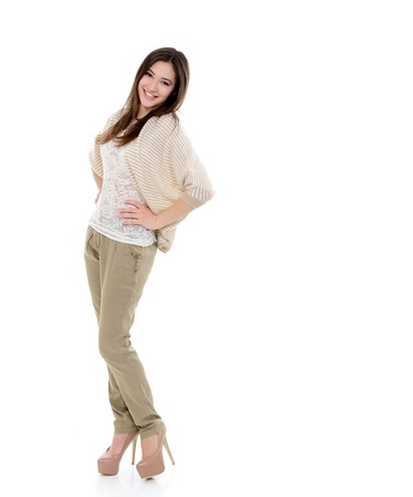 full length portrait of attractive teen girl looking at camera over white photo