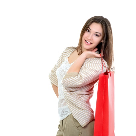 beautiful happy girl shopaholic with red shopping bags, over white photo