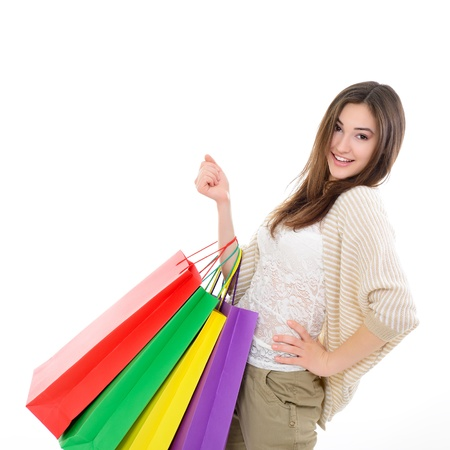 beautiful happy girl shopaholic with colored shopping bags, over white