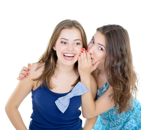 womans secret, two young beautiful women friends whisper funny news Stock Photo