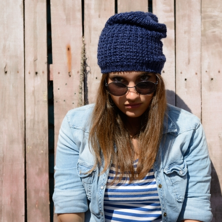 portrait of beautiful cool girl in hat and sunglasses photo