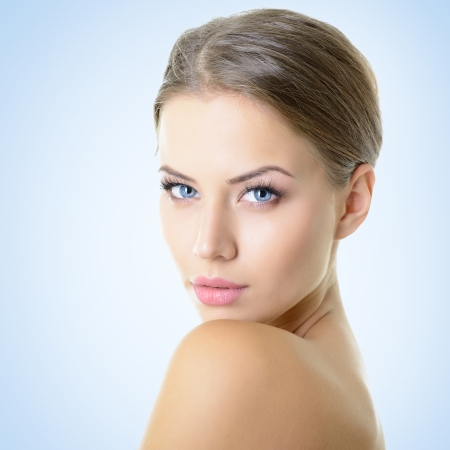 alluring women: Portrait of attractive young woman over blue background Stock Photo