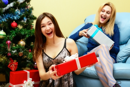 Christmas celebration. Mother and daughter with Christmas Gifts . New Year party Stock Photo - 22457803