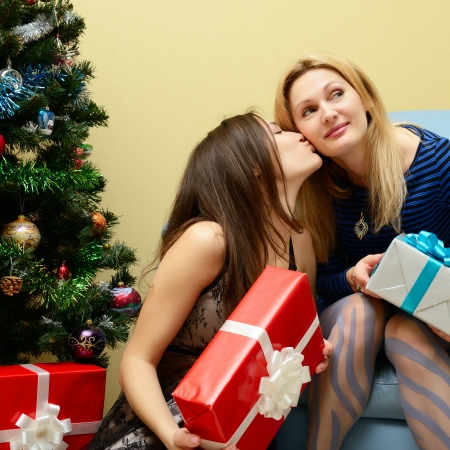Christmas celebration. Mother and daughter with Christmas Gifts . New Year party Stock Photo - 22457807