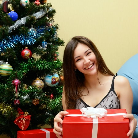 Christmas celebration. Teen girl with Christmas Gifts . New Year party  Stock Photo - 22457810