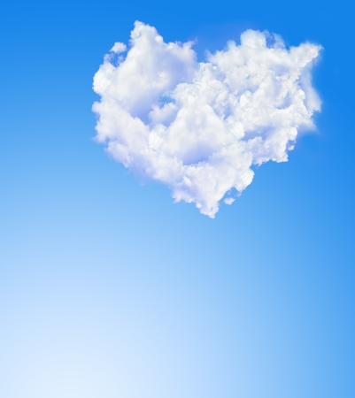 heart of white clouds over blue sky with copyspace photo