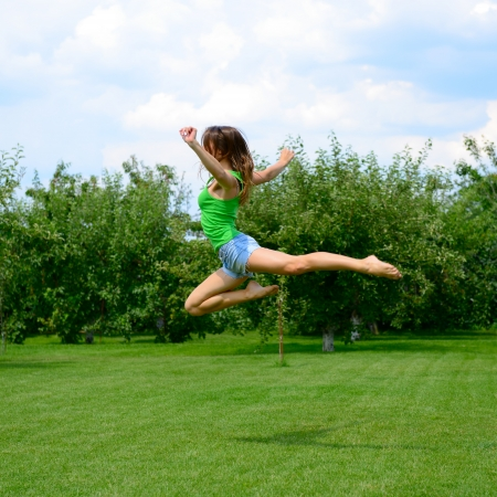 female gymnast: young beautiful dancer teen girl dancing and jumping, summer outdoor