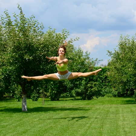 young beautiful dancer teen girl dancing and jumping, summer outdoor