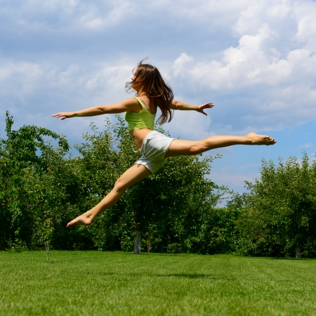 young beautiful dancer teen girl dancing and jumping, summer outdoor photo