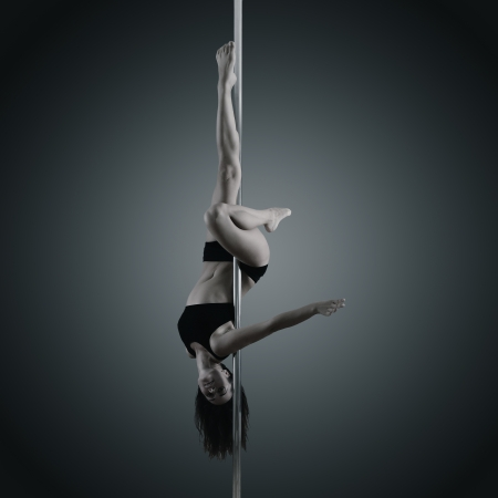 pole dancer, young woman dancing on pylon, toned and noise added photo