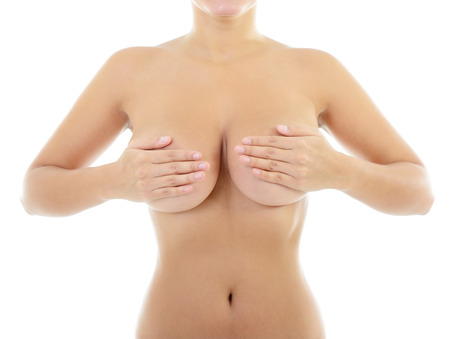 Body of beautiful woman covering her breast, over white photo