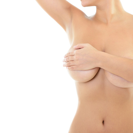 Body of beautiful woman covering her breast and showing armpit, over white photo
