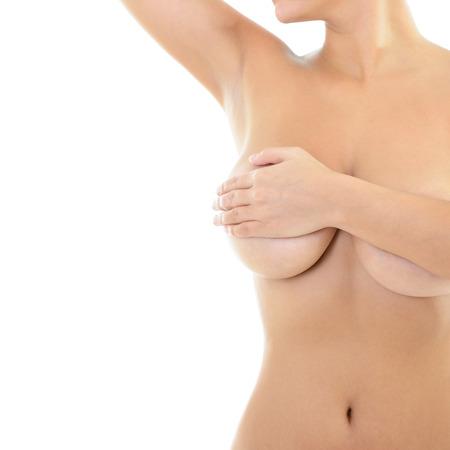 mujer desnuda senos: Cuerpo de mujer hermosa cubre su pecho y mostrando las axilas, en blanco Foto de archivo