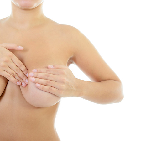 Woman with perfect body examining her breast of mastopathy or cancer, healthcare concept, palpation over white photo